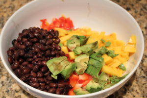 adding beans, mango, avocado