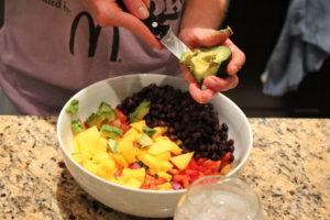 adding avocado