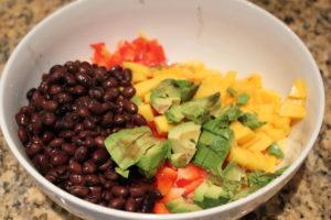 adding beans, mango, avocado